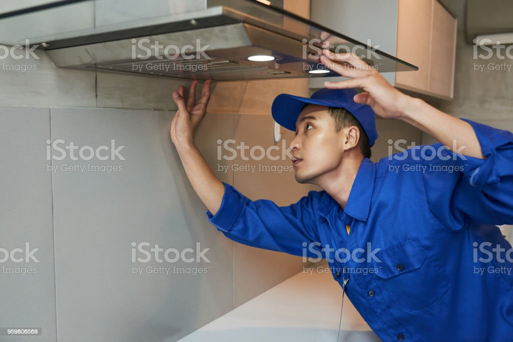 Installing cooker hood stock photo