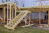 istock Installing deck boards with above ground deck, patio construction. 1198842612