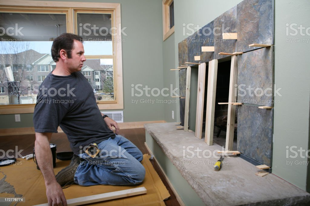Installing Fireplace Tiles royalty-free stock photo