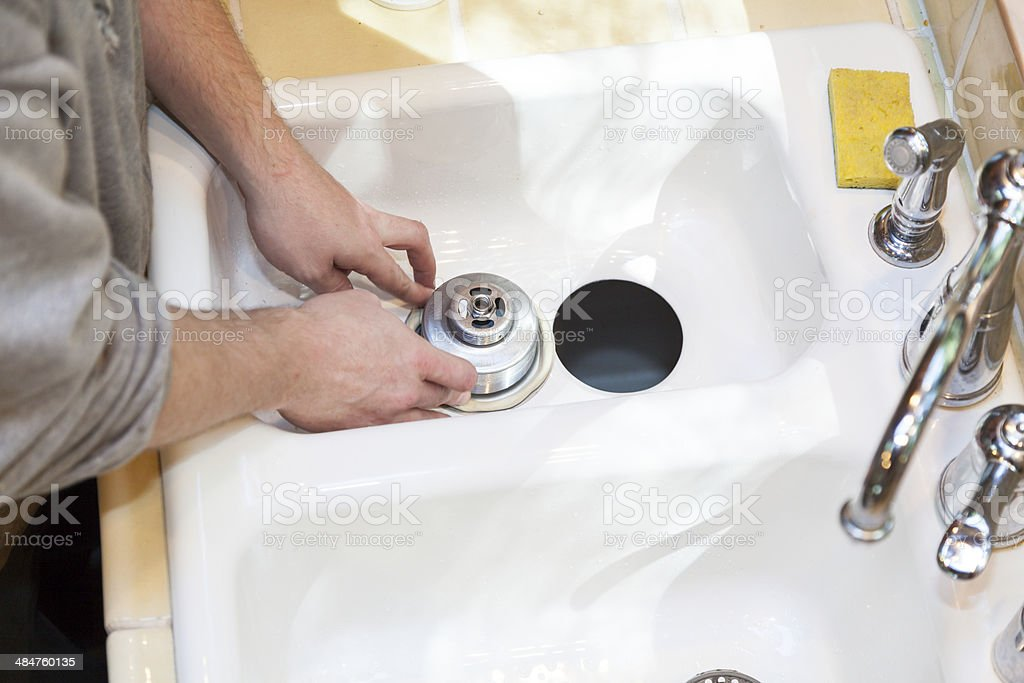 Installing Garbage Disposal stock photo