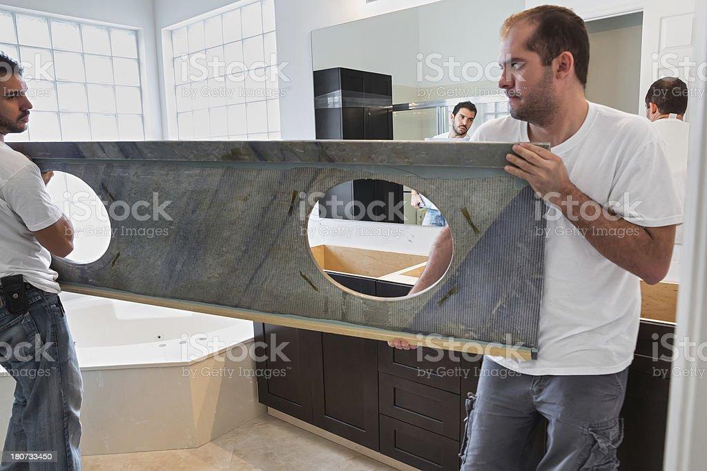 Installing granite and bathroom sink stock photo