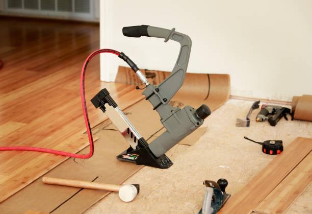 Installing hard-wood flooring stock photo