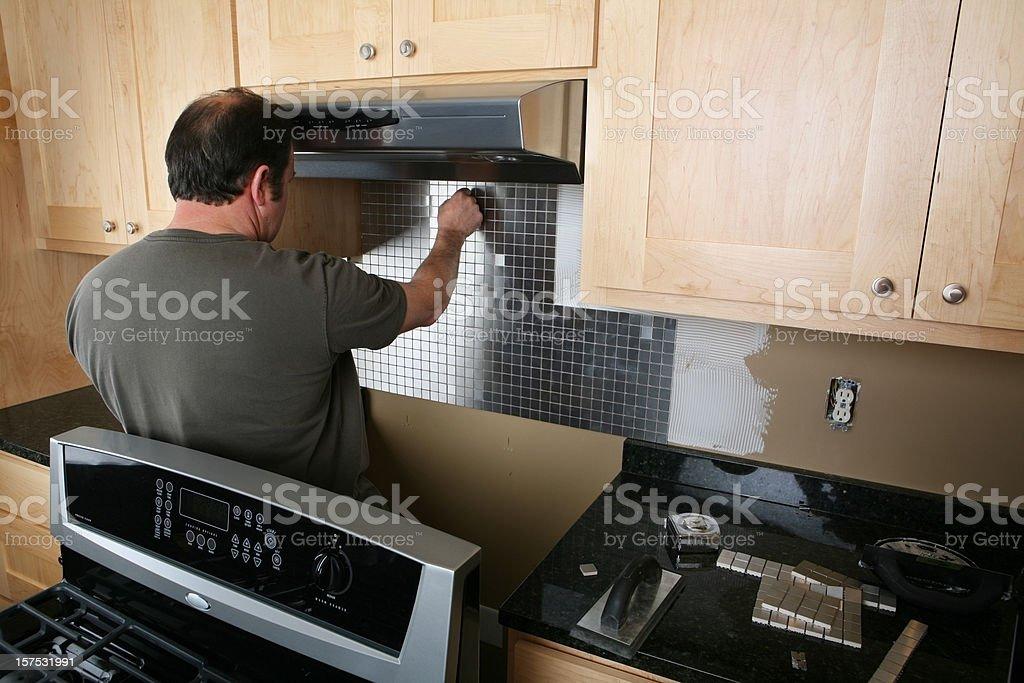 Installing Kitchen Back Splash royalty-free stock photo