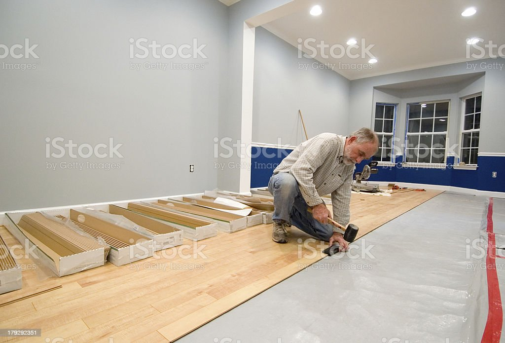 Installing Laminate Floor stock photo