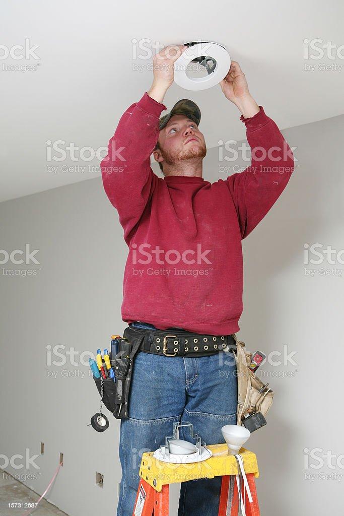 Installing Light Fixture stock photo