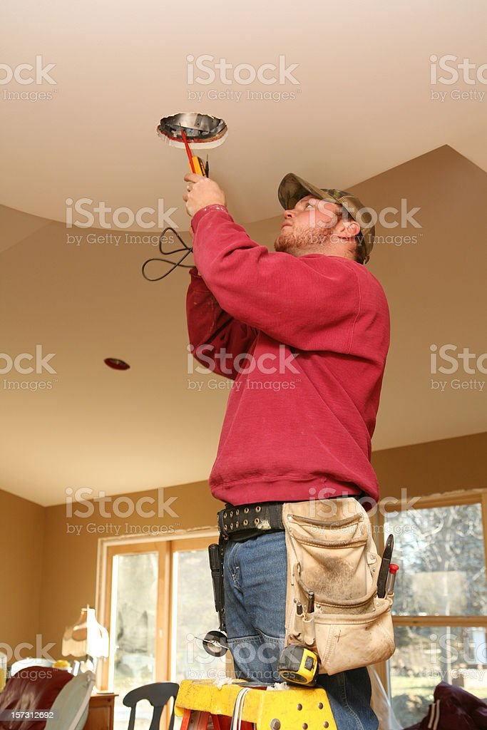 Installing Light Fixture royalty-free stock photo