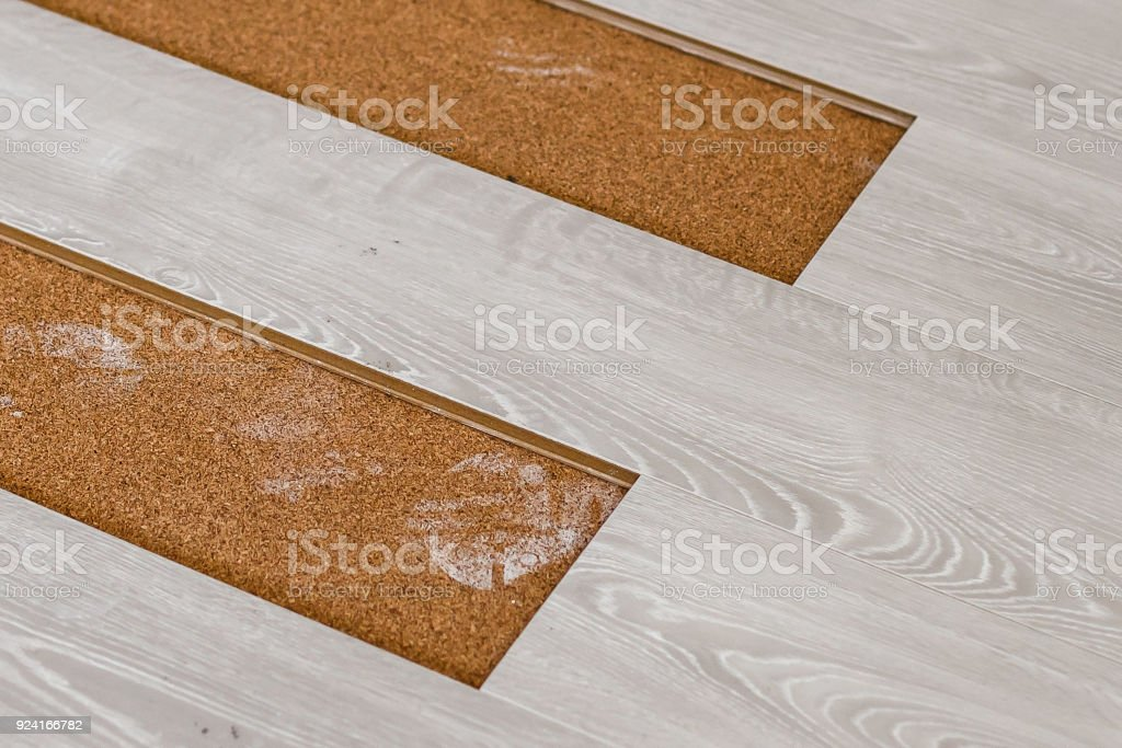 Installing Light Laminate Floor With Substrate Under A On White Background Royalty Free Stock