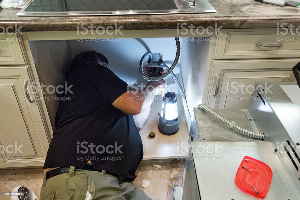 Installing new cook top range and oven in kitchen stock photo
