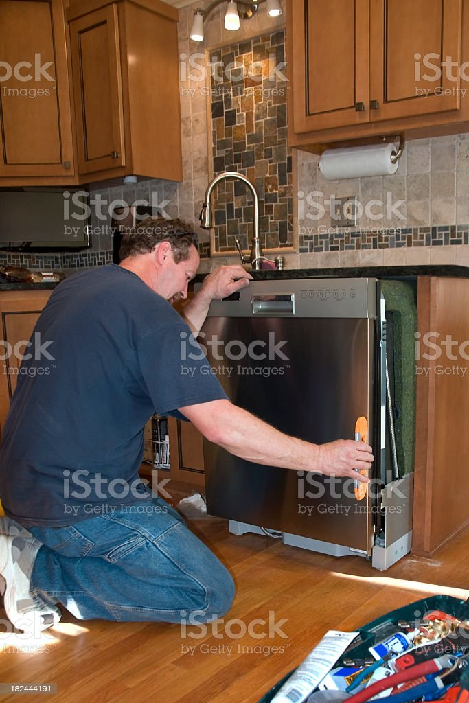 Installing New Dishwasher Kitchen Remodel royalty-free stock photo