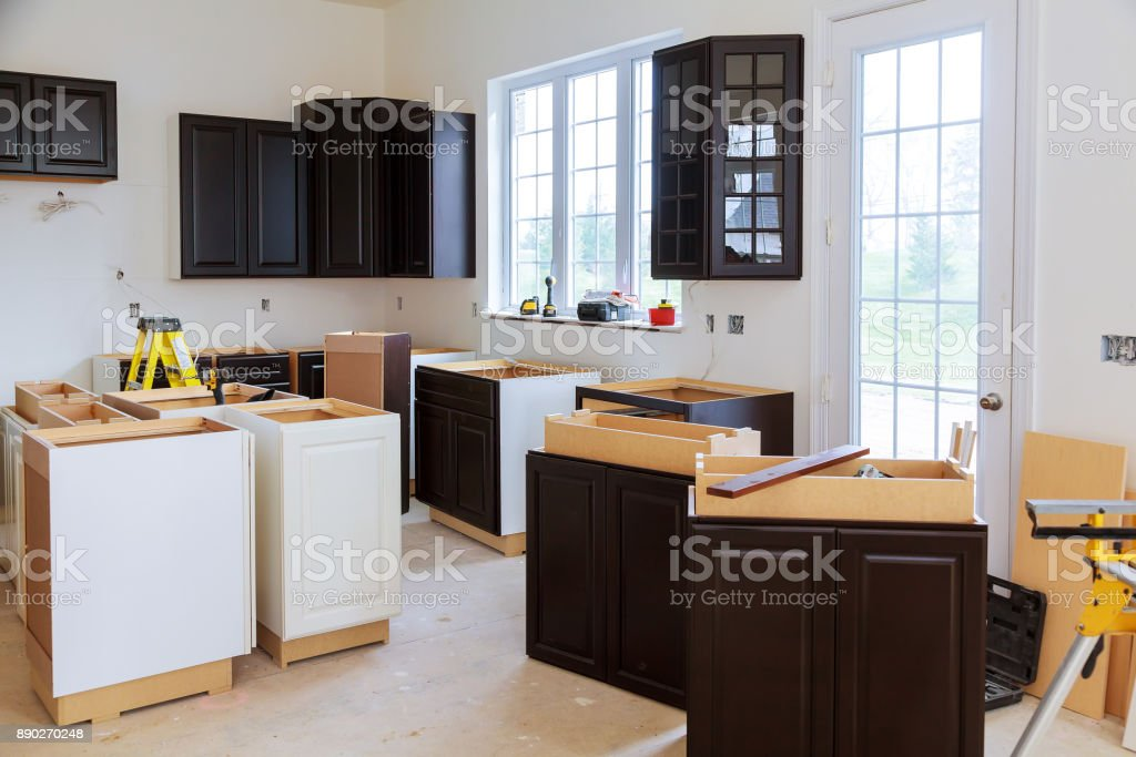 Installing new induction hob in modern kitchen kitchen stock photo