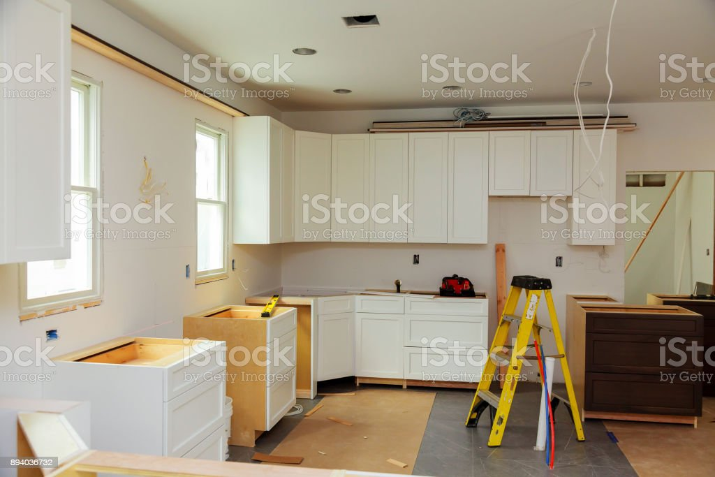 Installing new induction hob modern kitchen stock photo
