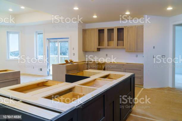Installing new induction kitchen kitchen installation of kitchen picture id1076414534?b=1&k=6&m=1076414534&s=612x612&h=qgr9ib6qj1tiqsnrqj64kvilcmd6r4j hzbs 0w2gf4=