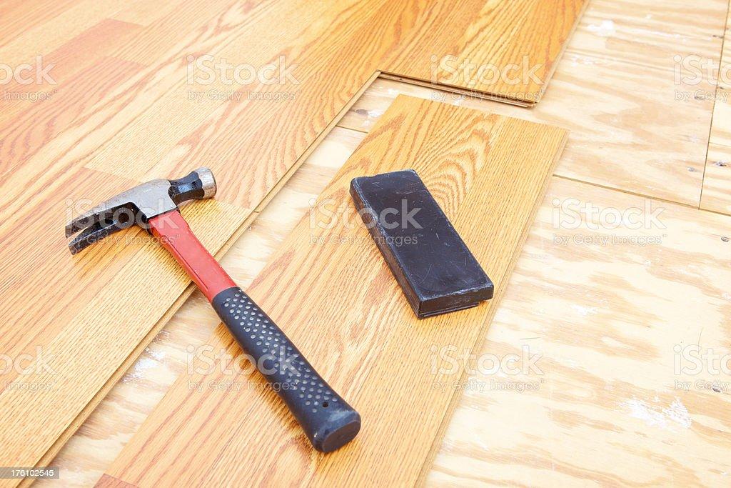 installing new laminate flooring royalty-free stock photo