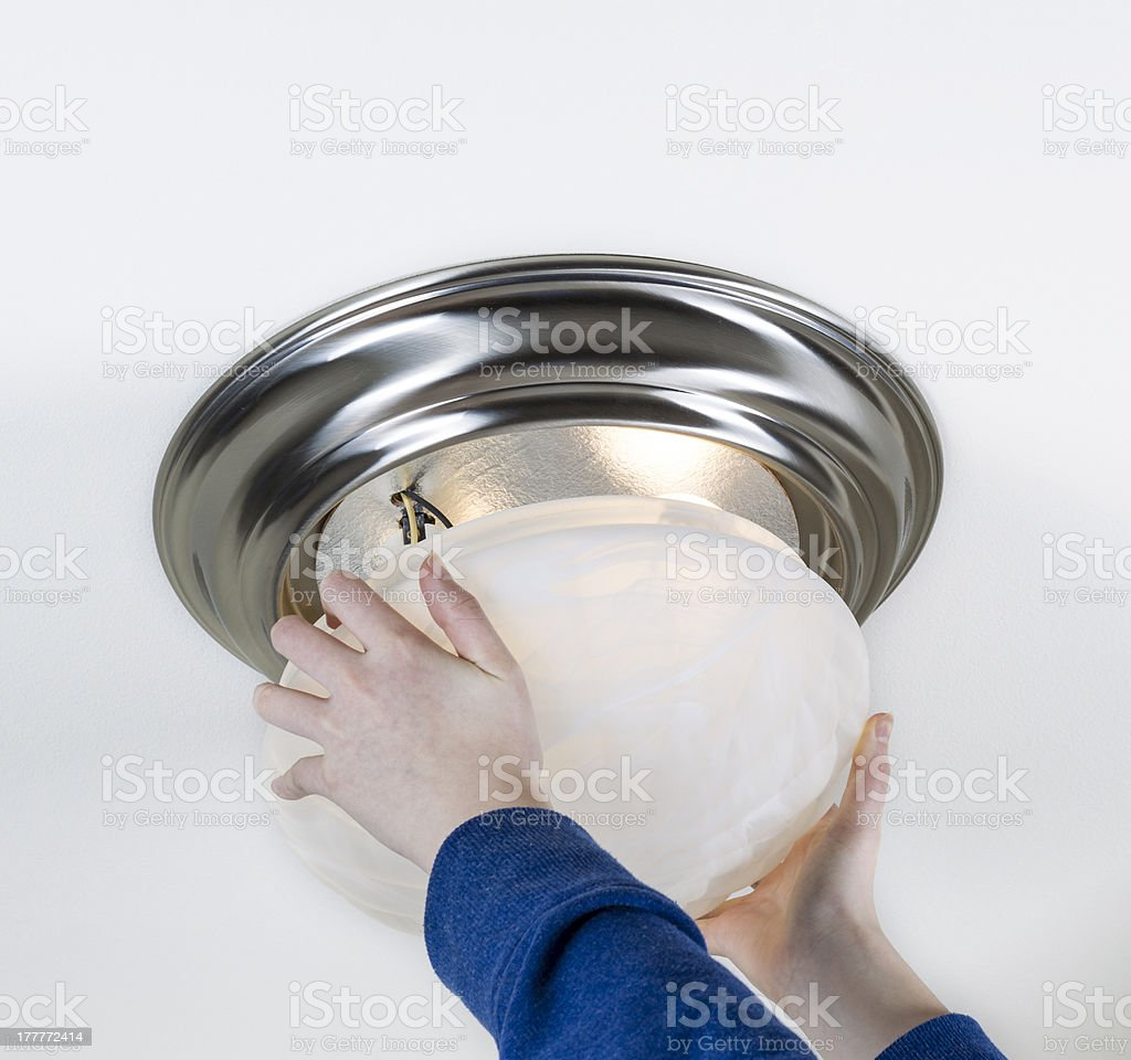 Installing New Light Bulbs royalty-free stock photo
