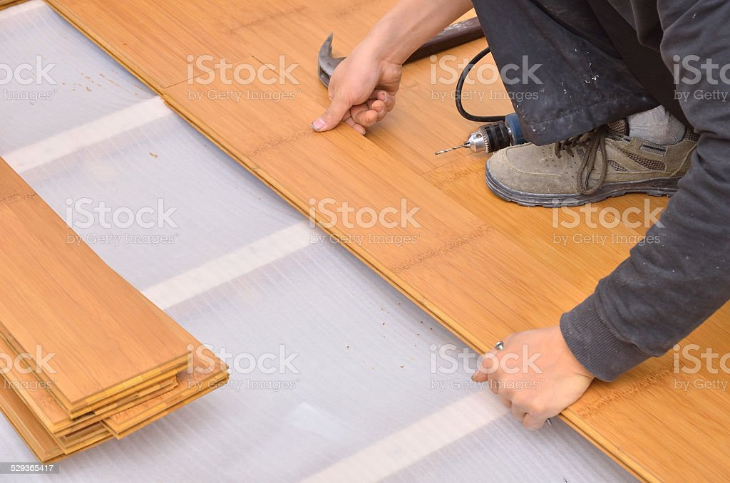 Installing parquet flooring stock photo