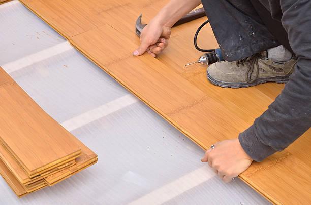 Installing parquet flooring stock photo