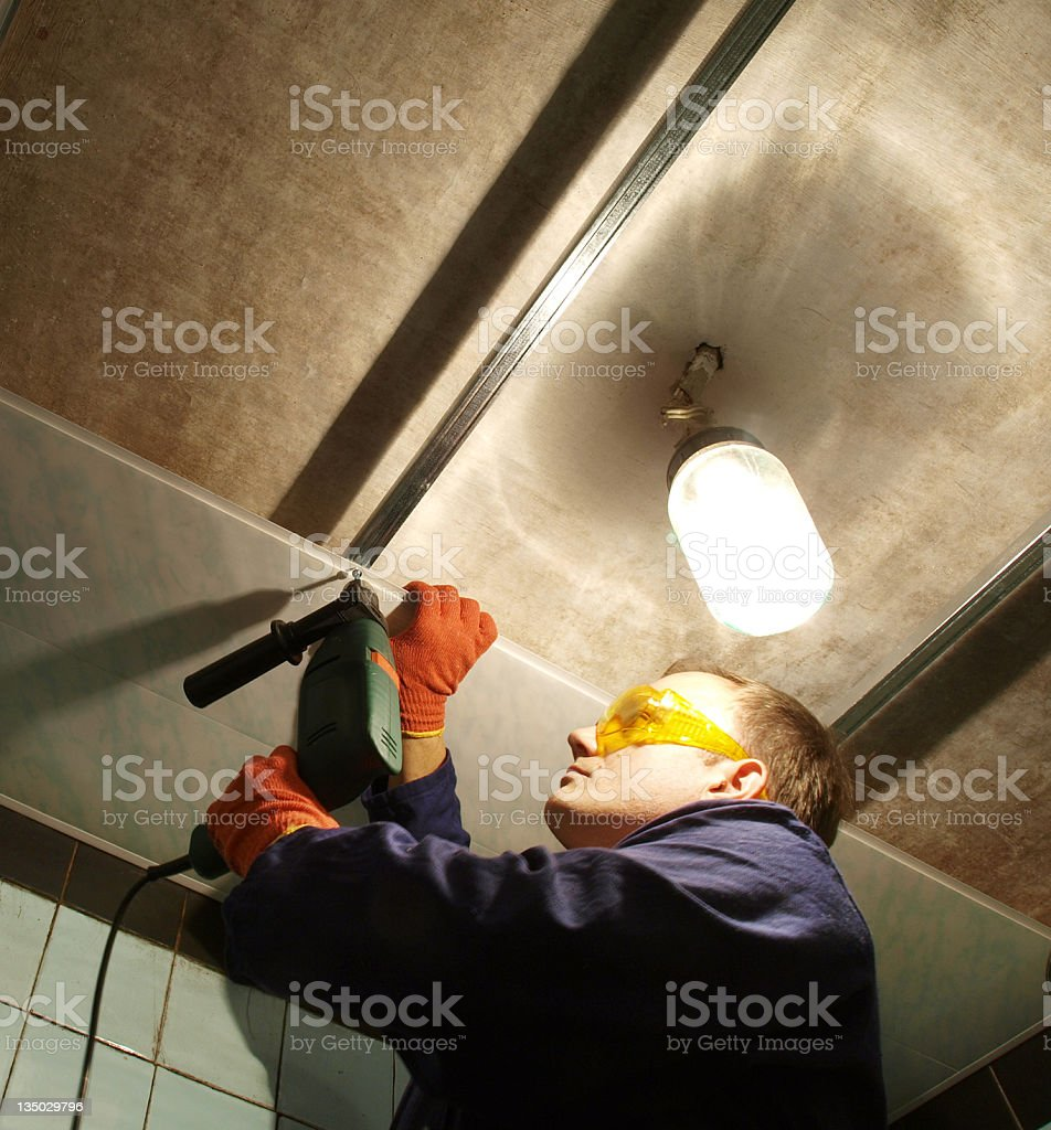 Installing pvc panels on ceiling royalty-free stock photo