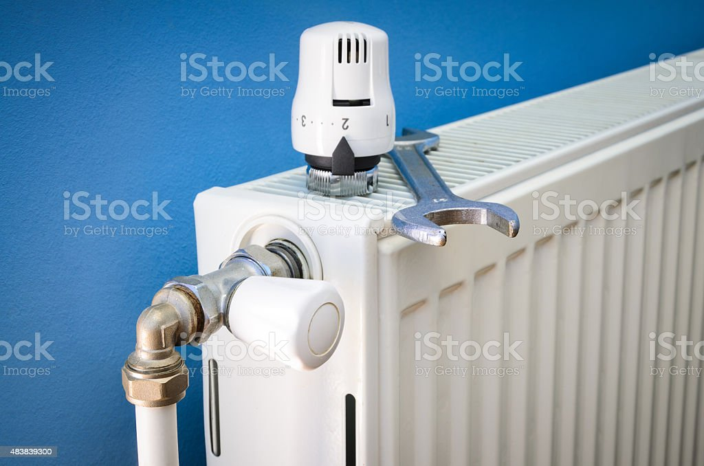 Installing radiator valve stock photo