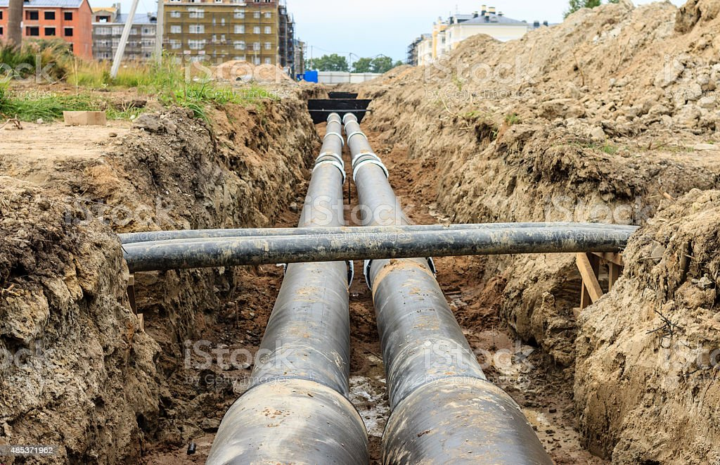 Installing the district heating pipe systems (Russia) stock photo