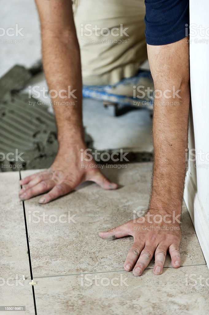 Installing Tiles royalty-free stock photo