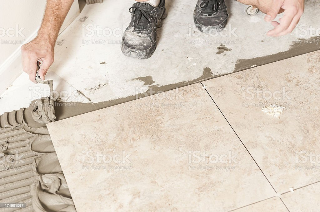 Installing Tiles royalty-free stock photo