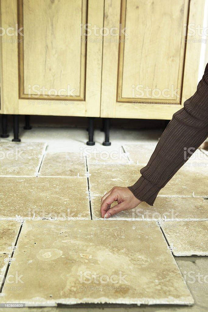 Installing Travertine Stone Floor Tiles stock photo