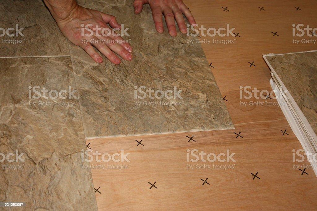 Installing Vinly Floor Tiles stock photo