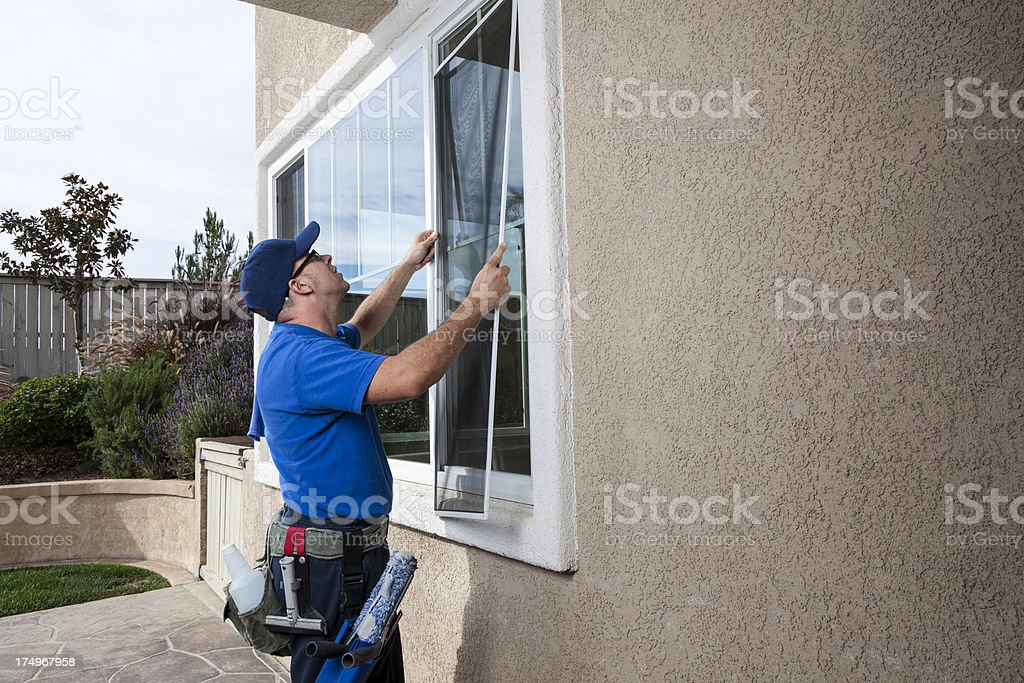 Installing Window Screen royalty-free stock photo
