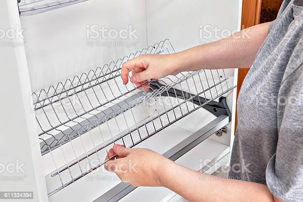 Installing wire dish rack for drying dishes inside kitchen cabinet picture id611334394?b=1&k=6&m=611334394&s=612x612&h=nxqza1cr77cglgd58y9sjzyjlmtmacxkrmh3pbrwvko=