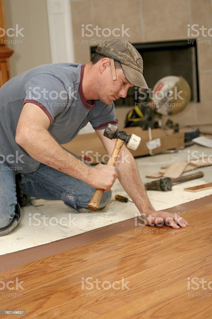 Installing wood floor 6. royalty-free stock photo
