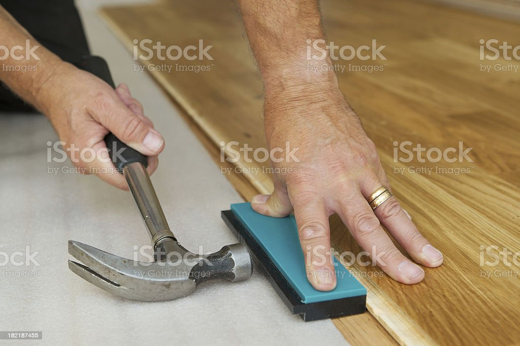 Installing wooden floor stock photo