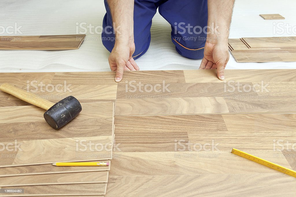 Installing wooden laminate flooring stock photo