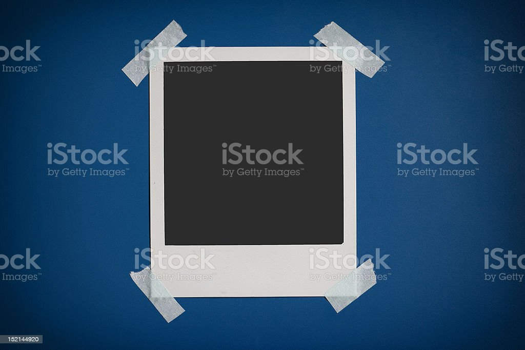 Instamatic Photo Frame Sticked to Background royalty-free stock photo
