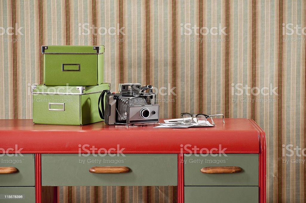 Instant Camera & Photo Boxes on Retro Desk stock photo