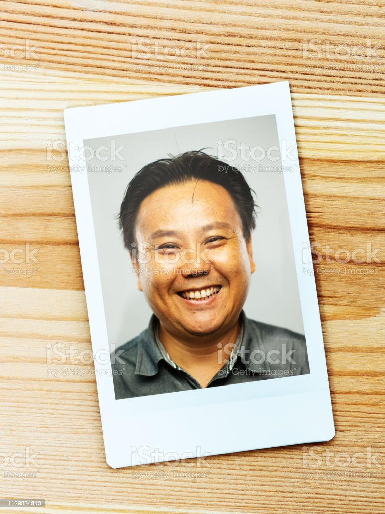 Instant camera portrait of real chinese mature man with excited expression  looking at camera royalty-