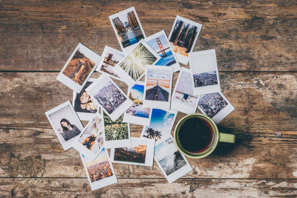 Instant camera prints on a table stock photo