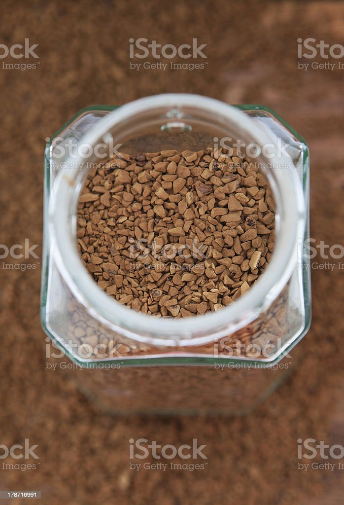 Instant coffee granules in glass bank royalty-free stock photo