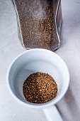 Close view of instant coffee with silver spoon.
