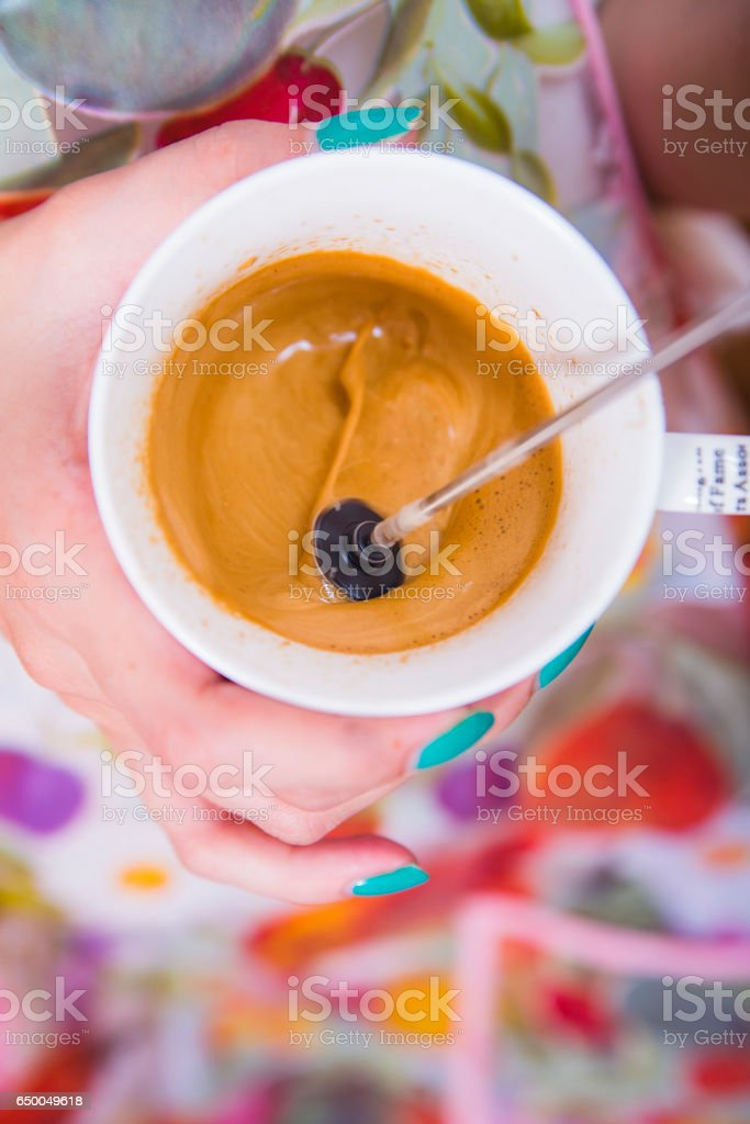 Instant coffee mixing stock photo