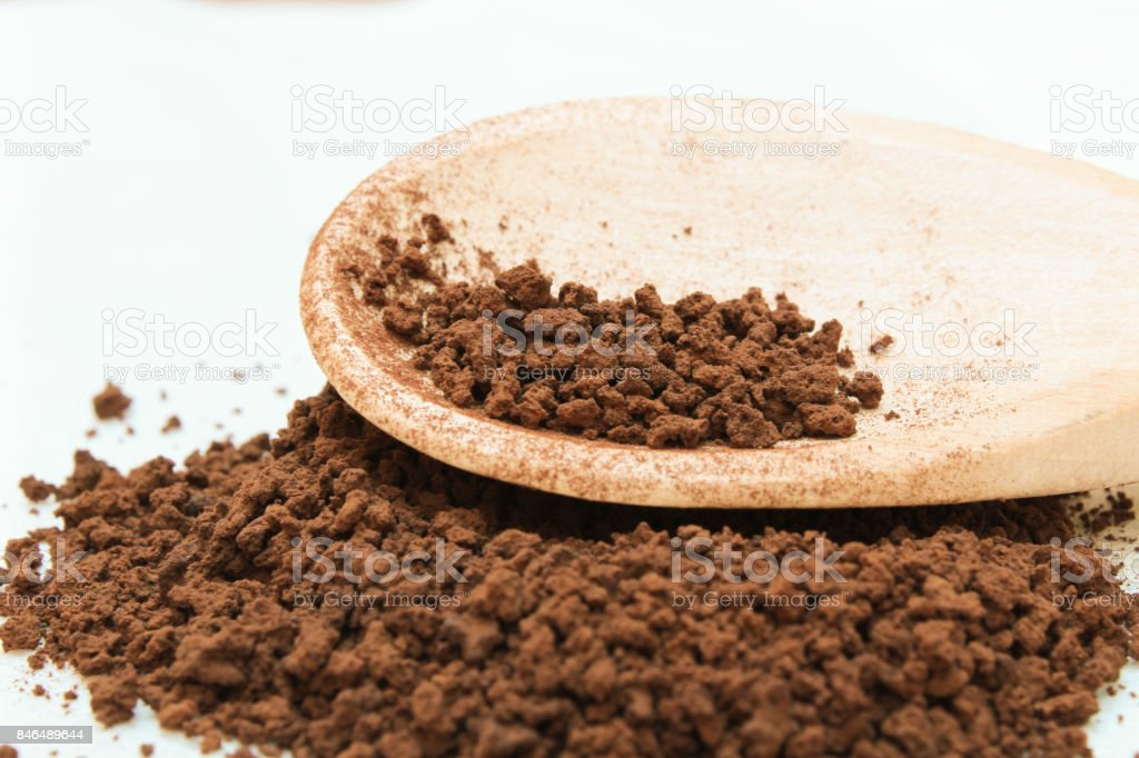 instant coffee on wooden spoon stock photo