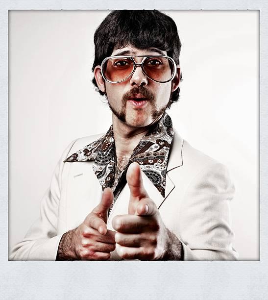 instant-disco mann mit dem finger zeigen - schnurrbart themenpartys stock-fotos und bilder