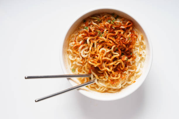 instant noodle Instant noodle and spicy seasoning in white bowl with chopstick pasta photos stock pictures, royalty-free photos & images
