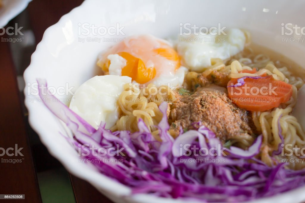 Instant noodles in cup on wood. royalty-free stock photo