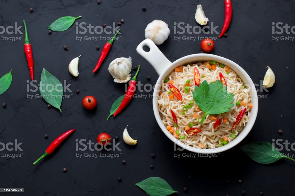 instant noodles in the bowl on dark background royalty-free stock photo