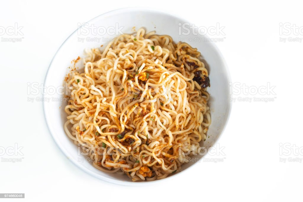 Instant noodles spicy ready to eaton in the bowl on white table wooden. stock photo
