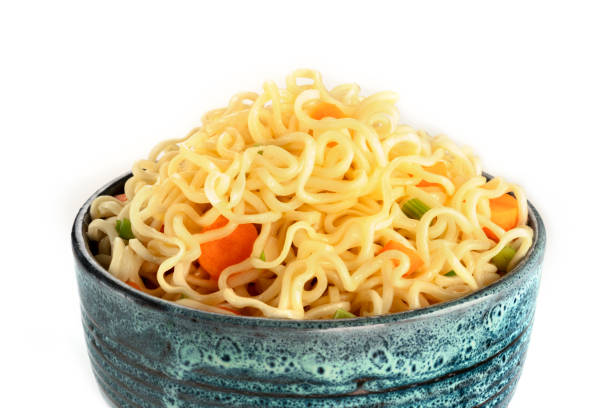 Instant noodles with carrot and scallions, vegetable soba bowl close-up on a white background stock photo