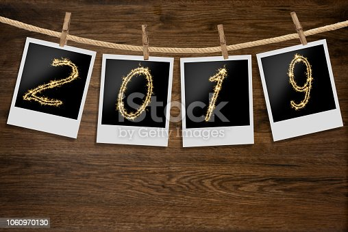 istock instant photo 2019 sparkle on wooden background 1060970130