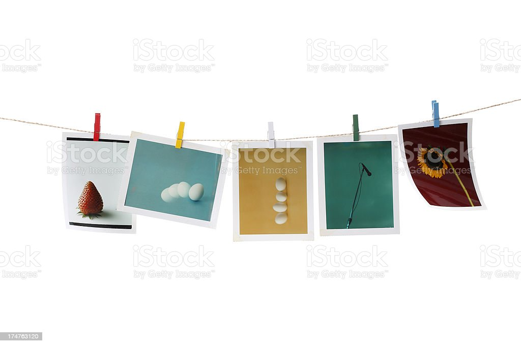 Instant photo prints on a washing line royalty-free stock photo