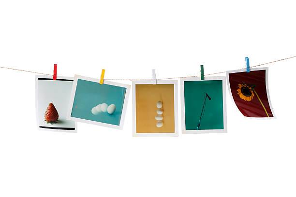 instant photo-prints auf dem waschen linie - blumenstreifen stock-fotos und bilder