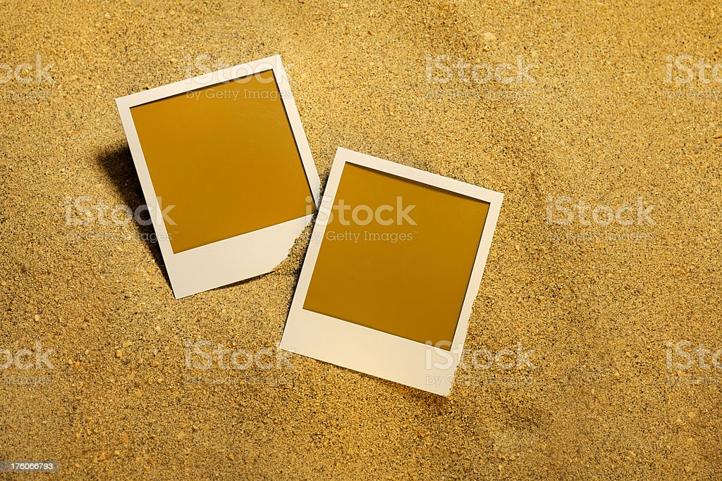 instant photos in the sand stock photo